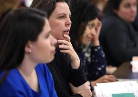 Boston, MA--2/5/2017 - Karen Foster (cq), center, flanked by Megan Beyer (cq), left, and Elizabeth Pimentel (cq), listen during a presentation. Women learn the art of door-knocking, during candidate training. Photo by Pat Greenhouse/Globe Staff Topic: CandidateTraining Reporter: Stephanie Ebbert